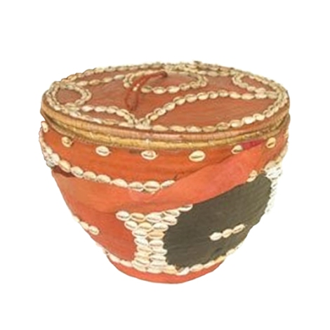 Yoruba basket covered with red and black cloth and cowrie shells