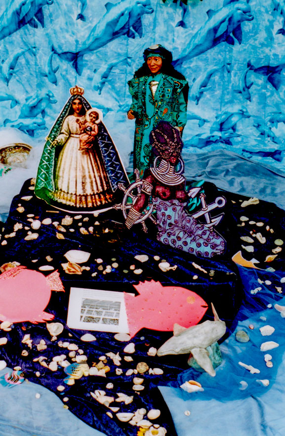 Detail of Ofrenda/altar-view of Yemaya-Olokun, La Virgen de la Regla, and Egun (ancestor) doll